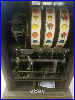 1929 Mills New Jackpot Bell Poinsettia 5 Cent Slot Machine