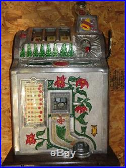 1929 Mills Novelty Company Poinsettia 5-cent slot machine and accessories