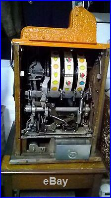 1930's MILLS WAR EAGLE 5 CENT SLOT MACHINE WITH JACKPOT PAYOUT