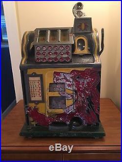 1931 Mills Lion Head antique slot machine