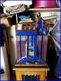 1932 Mills Skyscraper nickel slot machine and display base