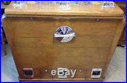 1940 antique Keeney Bonus Super Bell Three Way console slot machine