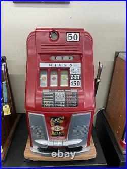 50c Antique Mills Vintage slot machine