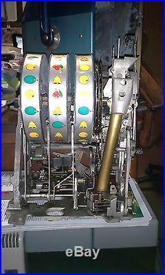 ANTIQUE 1947 MILLS BLUE BELL CRISS CROSS HI TOP NICKEL SLOT MACHINE
