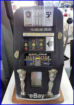 Antique Slot Machine With Guide Book