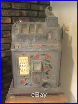 Antique 30s 40s mlls 25 cent slot machine with stand poinsettia Golden Nugget