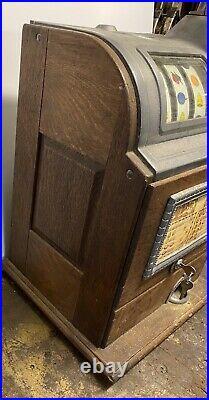 Antique Jennings 25 Cent Slot Machine