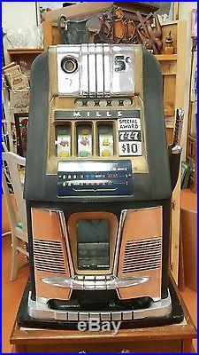 Antique Mills 5-cent hi-top antique slot machine
