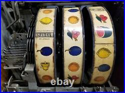 Antique Mills Bursting Cherry / Melon Bell slot machine