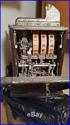 Antique Mills Dime coin slot machine