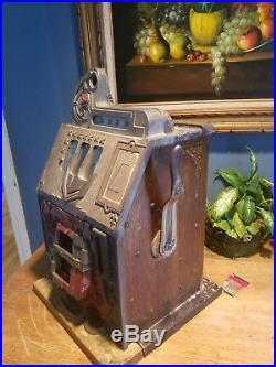 Antique Mills nickle slot machine (gold award)