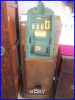 Antique Slot Machine Three Slots, Wood and Green Metal Exterior