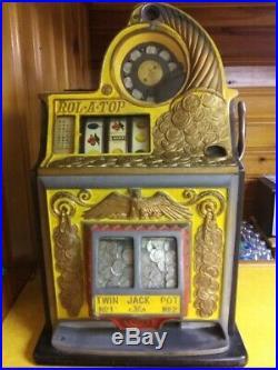 Antique rol-a-top nickel slot machine