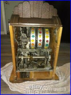 Antique vintage Mills Extraordinary 25 Cent Slot machine