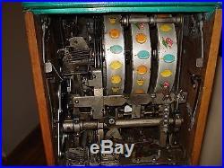 Antique vintage Mills Extraordinary Art Deco 25 cent slot machine