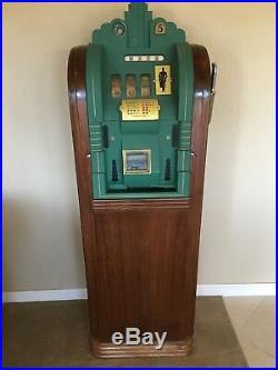Antique vintage Mills Extraordinary Page Boy slot machine