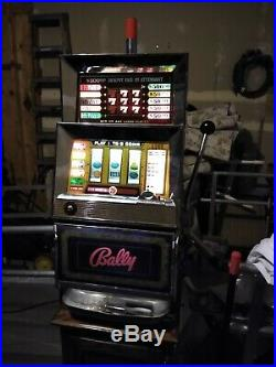Bally vintage slot machine 25 cent with stand