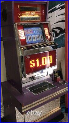 Ballys Vintage Video Poker Machine. Takes Dollar Tokens. Stand/base is included