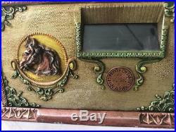 Circa 1916 RARE example of token pay-out machine-aluminum-horse race theme