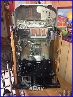 Circa 1948 Mills 50 Cents Slot Machine. Special Award 777