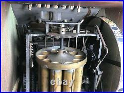 Earlier 1900's Mills Check Boy Slot Machine