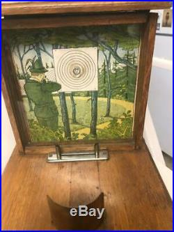 Early table model FRENCH gun shooting game with token pay-out for a winner