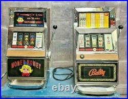 Lot of 2 Las Vegas Casino BALLY 945-1 Slot Machine 25 cent Coin Money Honey