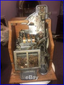 Matched Pair of Mills Q. T. Slot Machines