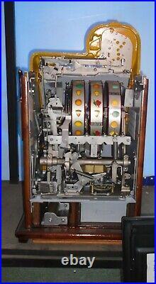 Mills 10-cent DEUCES WILD DIAMOND FRONT antique slot machine, 1937