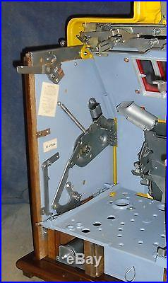 Mills 10-cent DEUCES WILD Diamond Front antique slot machine, 1941