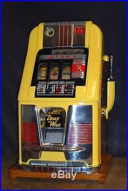 Mills 10-cent DEUCES WILD hi-top antique slot machine, 1950