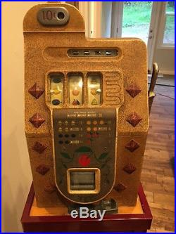 Mills 10 cent Diamond front slot machine with Mills stand