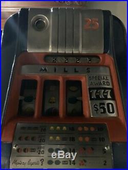 Mills 25 Cent 777 hi-top antique slot machine