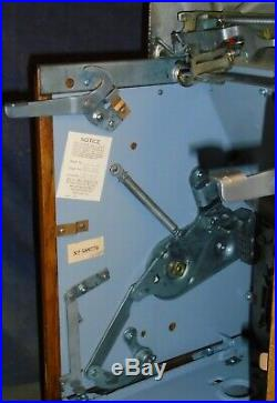 Mills 25-cent 777 CHROME hi-top antique slot machine, 1949