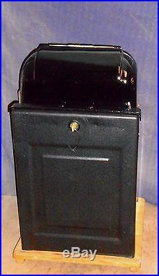 Mills 25-cent 777 hi-top antique slot machine, 1947