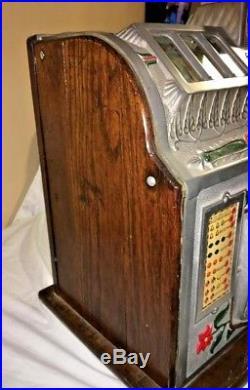 Mills 25 cent Poinsettia Slot Machine