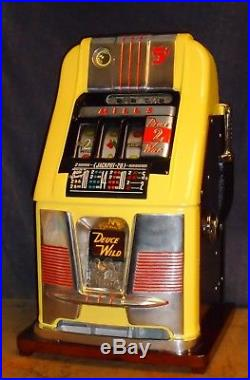 Mills 5-cent DEUCES WILD hi-top antique slot machine, 1947