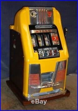 Mills 5-cent DEUCES WILD hi-top antique slot machine, 1948