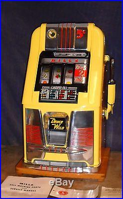 Mills 5-cent DEUCES WILD hi-top antique slot machine, 1950