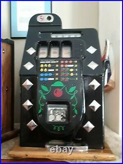 Mills 5-cent slot machine collectible excellent condition