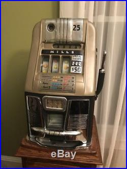 Mills 777, quarter Slot Machine, With Money Box. Including Stand