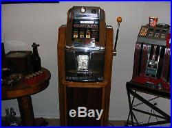 Mills Fremont Hotel $1 Slot Machine in Regal Stand. Original Machine