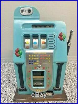 Mills Golden Falls antique slot machine