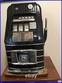 Mills High Top slot machine. 5 cent black and chrome