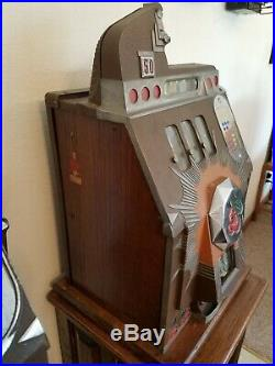 Mills Novelty Company 50-Cent Brown Front Slot Machine and Ornate Stand