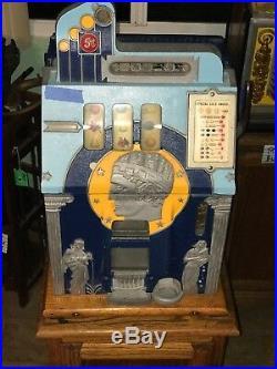 Mills Novelty Company Roman Head 5-Cent Slot Machine, Side Vendor withGold Award