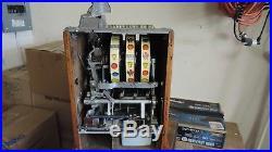 Mills Poinsetta. 25 cent slot machine