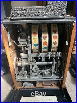 Roman Head 5 Cent Slot Machine by Mills Novalties Original / Vintage / Antique