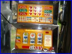SLOT MACHINE Summit Systems TRIPPLE 7'S Quarter operated slot machine