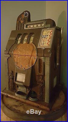 VINTAGE 5 cent nickle roman head slot machine - RARE - mills silent gold
